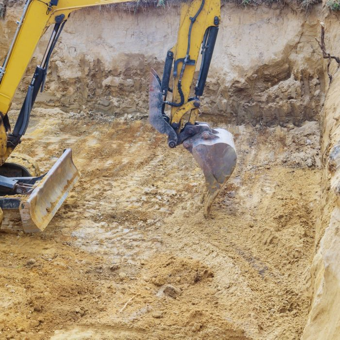 excavator-during-earthworks-backhoe-on-work-digs-ground-during-earthworks-for-the-foundation_t20_kLOn4p