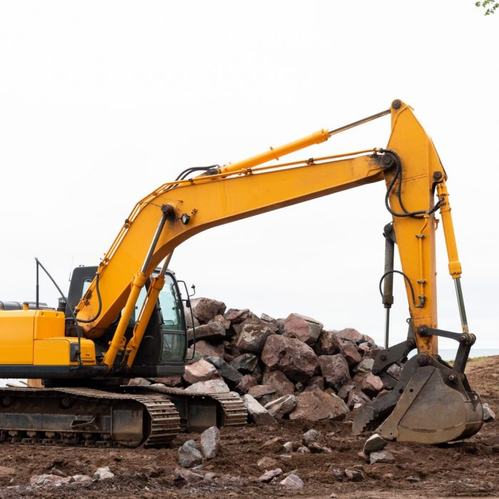 heavy-duty-excavator-along-lakefront-repairing-breakwater-wall-photo-of-heavy-duty-digging-equipment_t20_roambB