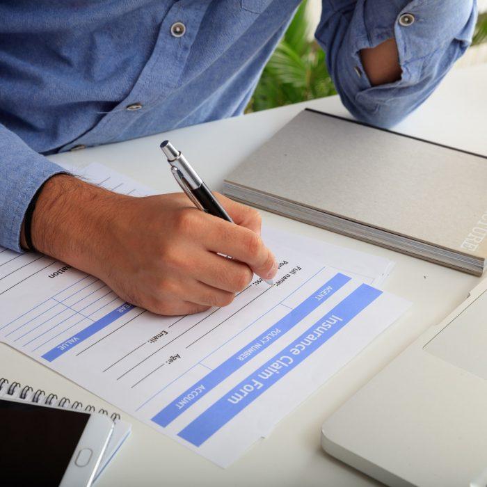 Man preparing an Insurance Claim Form